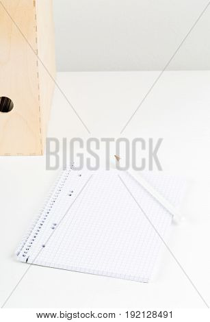 White office desk with empty notepad pencil and folders - study or workplace background mock up