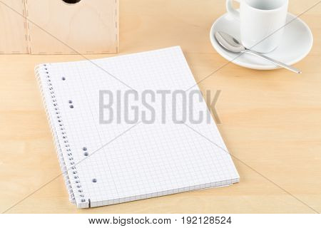 Brown wooden office desk with empty notepad cup and folders - study or workplace background mock up