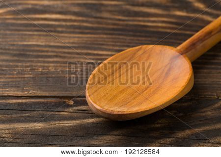Empty wooden cooking spoon on wood board or table with copy space