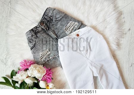 Gray Ragged Shorts, White Jeans And Peonies On White Fur. Fashionable Concept