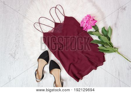 Bordeaux T-shirt With Lace, Shoes And Peony On White Fur. Fashionable Concept