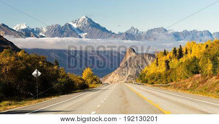 The highway leads on below the Chugach Mountains in Alaska