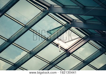 Glass skylight roof with open window architectural feature detail