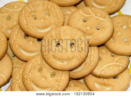 Background of the tasty round smiling cookies