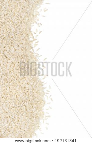 Long parboiled rice scattered on white background. Copy space for your text. Top view high resolution product. Healthy food concept