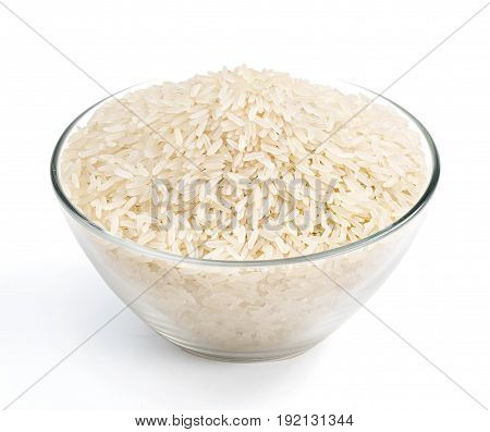 Healthy food. Heap of parboiled rice in glass bowl isolated on white background. Close up high resolution product.