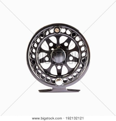 Fly Reel black on white background. Fly reel for fly fishing. Fly reel close-up.