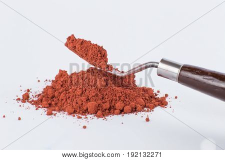 Red Moroccan Ochre pigment on a white background