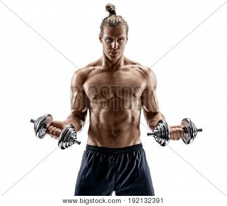 Powerful bodybuilder doing the exercises with dumbbells. Photo of strong male with naked torso isolated on white background. Strength and motivation.