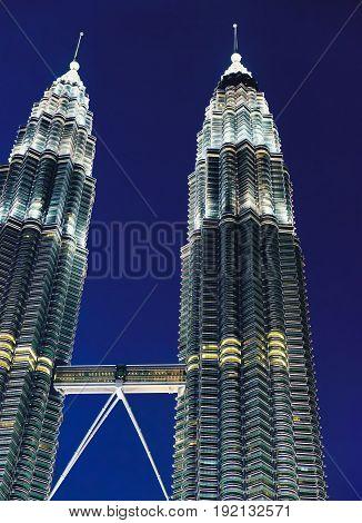 Kuala Lumpur, Malaysia - February 10, 2016: The most popular tourist destination in Malaysian capital - Petronas Towers at night.