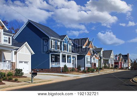 Generic, Colorful Houses on Suburban Neighborhood Street on a Sunny Day