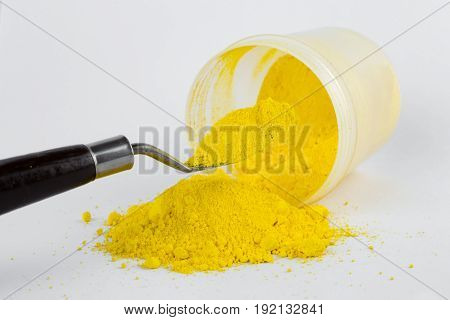 Cadmium Yellow medium pigment on a white background