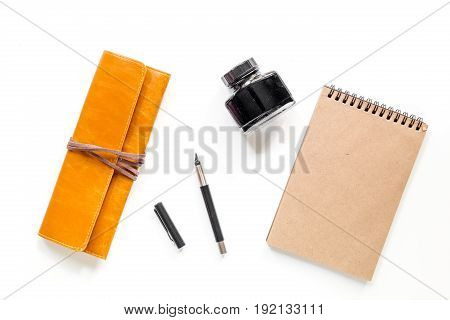 Writer workplace with vintage notebook on white background top view mockup.