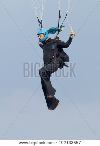 Skydiver Hanging From Parachute Focusing And Aiming For Perfect Landing On Final Approach.