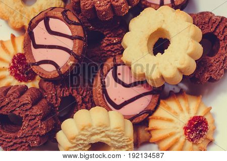 Dessert, cookies of wound kinds and tastes, with different fillings from confiture and jam. The taste of chocolate and raspberries and strawberries.