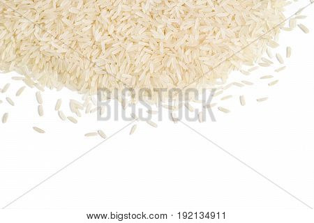 Parboiled rice scattered on white background. Copy space for your text. Top view high resolution product. Healthy food concept
