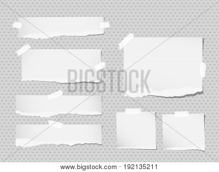 White ripped notebook, copybook sheets stuck with sticky tape on grey dotted pattern