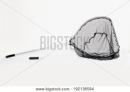 Fishing net landing net on white background. Folding landing net