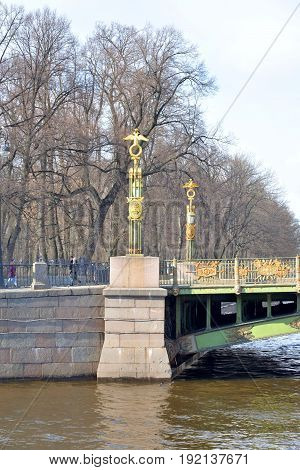 Panteleimon Bridge across the Fontanka River at sunny spring day in St. Petersburg Russia.