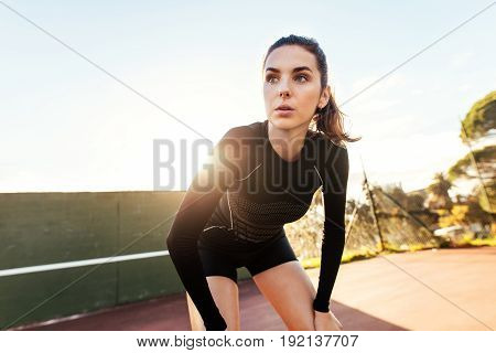 Beautiful Woman Resting After Workout On Tennis Court