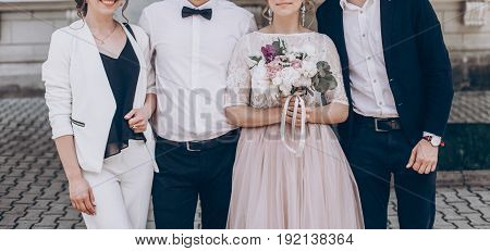 Stylish Wedding Bride With Bouquet And Groom Taking Photo With Family With Bridesmaid And Groomsmen