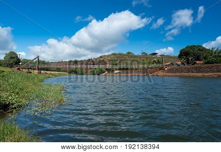 Wide angle view of the famous wooden suspension swinging bridge to cross the river in Hanapepe Kauai
