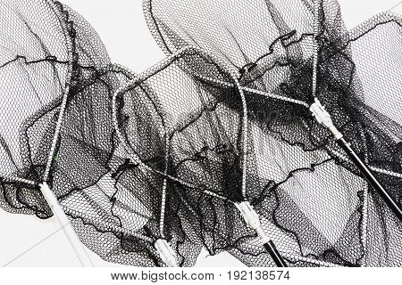 Group of different fishing nets on a white background Fishing net landing net on white background. Folding landing net