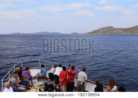 KORNATI NATIONAL NATURE RESERVE, CROATIA - SEPTEMBER 7, 2016: People are settled comfortably aboard the pleasure boat.