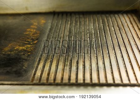 ribbed cast iron surface grill, metal texture