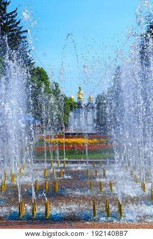 people have a rest in city park with fountains in Chernihiv