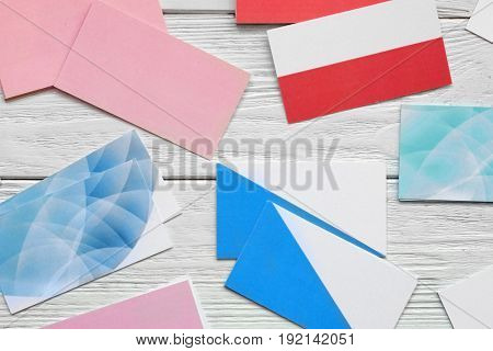 Composition with blank business cards on wooden background