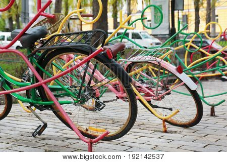 Colorful bicycle rack with bikes in park