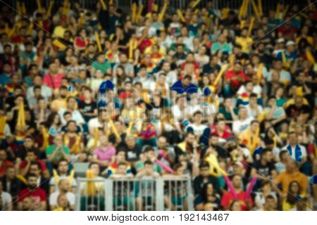 blurred crowd of people in a stadium