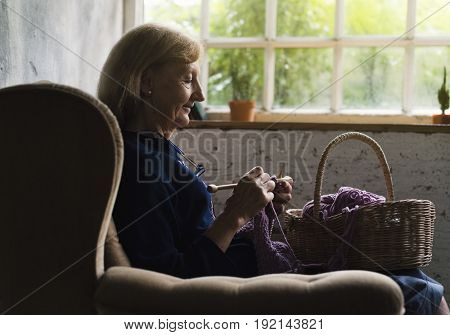 Closeup of senior caucasian woman knitting handicraft hobby