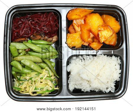 Compartment Bento Lunch Boxe with Pork and Veggies over white. Pork, Mango, Peas, Beets, Squash, Rice.