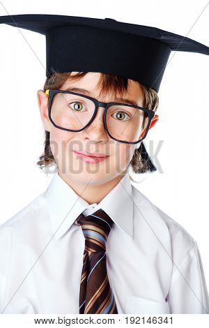 Portrait of a smart student boy in white shirt, a tie and academic hat. Educational concept. Isolated over white.