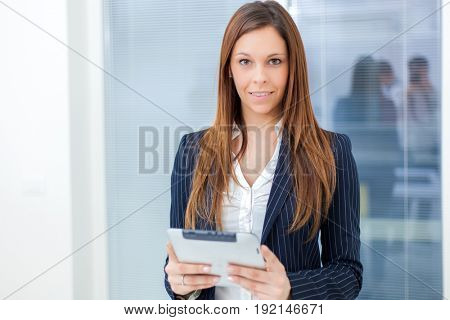 Businesswoman holding a digital tablet