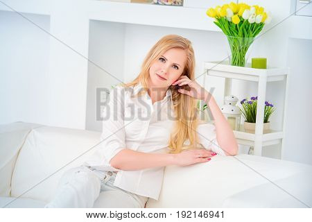 Portrait of a beautiful well-groomed middle-aged woman at home. Skincare, rejuvenation, cosmetics.