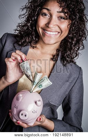 Black woman with piggy bank
