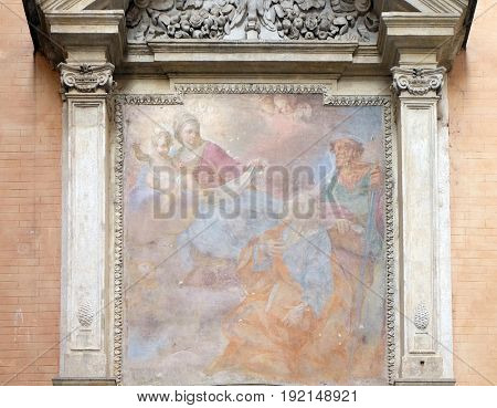 ROME, ITALY - SEPTEMBER 03: Our Lady holding the Christ Child and seated on the clouds, with St Peter and Paul looking on in adoration Church of San Giovanni della Pigna, Rome on September 03, 2016.
