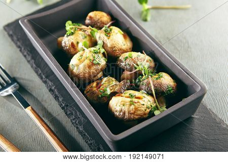 Restaurant Food - Fried Mushrooms with Greens. Gourmet Restaurant Garnish Menu