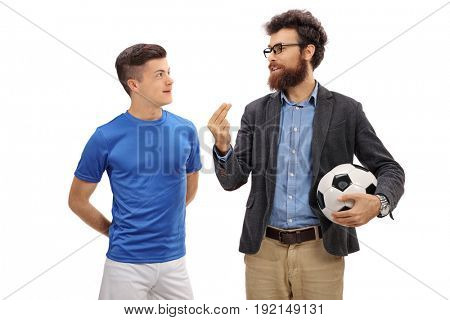 Father with a football explaining something to his teenage son isolated on white background