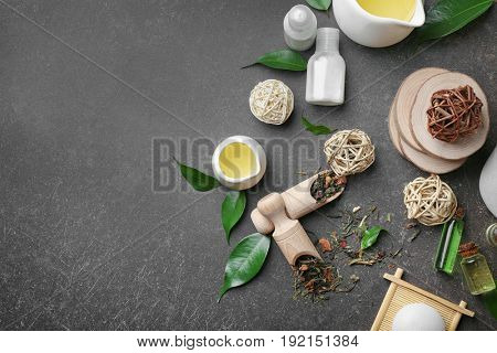 Spa composition with tea tree oil on gray background