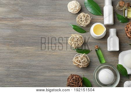 Spa composition with tea tree oil on wooden background