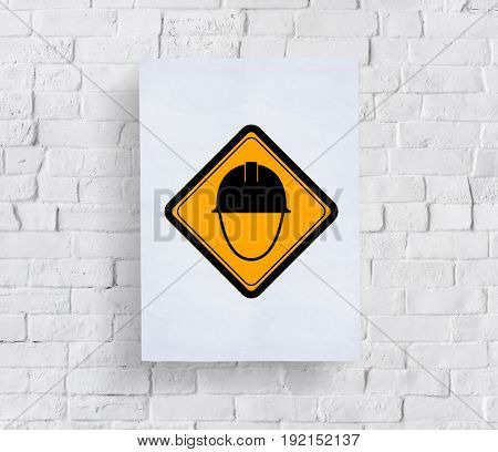 Safety Helmet Sign Attention Banner Put in Concrete Wall