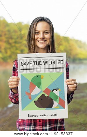 Woman holding save animals banner