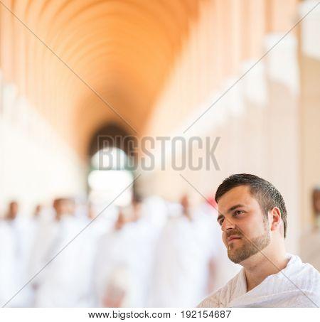 Muslim man enjoying his visit to holy mosque