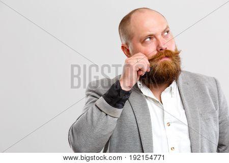 Man beard looking into side