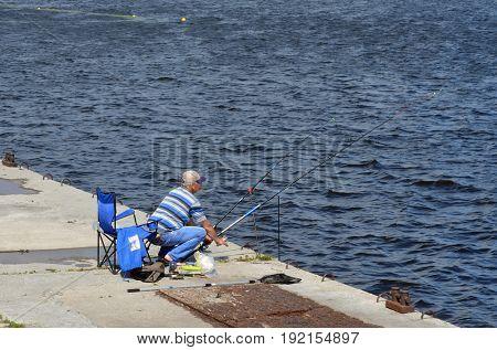 An unidentified person fishing.Modern residential area Obolon.June 21 ,2017 in Kiev, Ukraine
