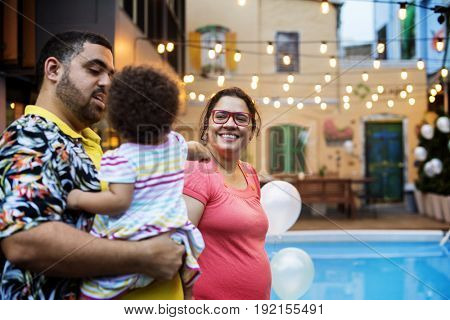 Family walking beside the swimming pool party
